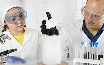 A scientist conducts chemistry classes for a schoolgirl